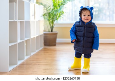 Toddler boy bundled up in winter clothes ready to go outside