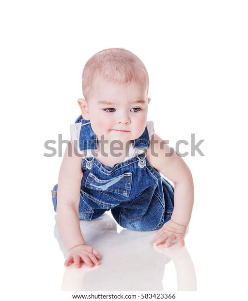 Toddler boy crawling forward isolated on white