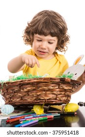 Toddler boy with  Easter basket making decorations