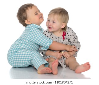 Toddler boy and girl, cute hugging in studio on a white background. The concept of a harmonious development of a child in the family, a happy childhood. Isolated.