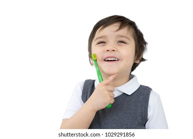 Toddler boy holding toothbrush and pointing his finger on his chin isolated on white background, Kid boy learning how to brush his teeth at school,Child development or Dental hygiene concept