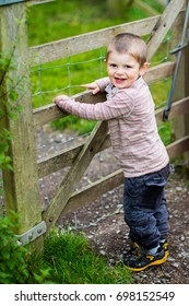 Toddler boy out for countryside walk