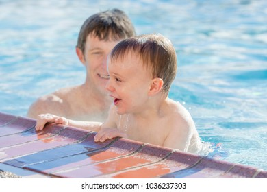 Toddler Boy Playing in a Warm Water Pool with his Father During the Winter at Ski Resort