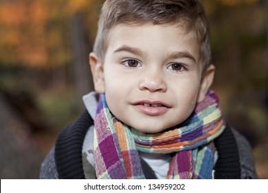 toddler boy smiling during fall