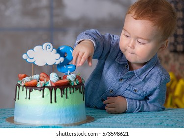 Toddler Boy Tasting Birthday Cake