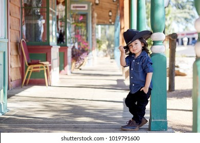 Toddler boy wearing a cowboy outfit poses for a portrait in Tucson, AZ.