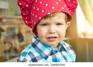 Toddler in chef hat. Adorable little boy.