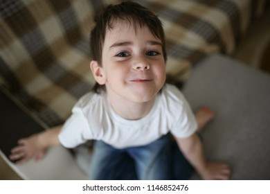 Toddler child happy on the couch in the real room at home, lifestyles and toning
