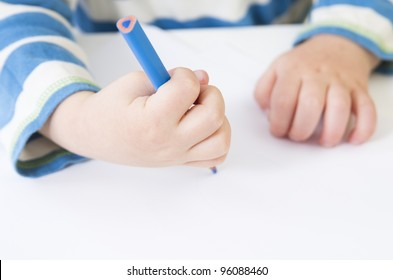 Toddler demonstrates a poor pencil grip