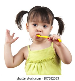 Toddler doing dancing moves while brushing her teeth