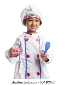 Toddler Dressed as a Little Chef holding a Spatula and Oven Mitt, isolated, white