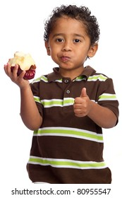 Toddler Eating Apple and Giving Thumb Up