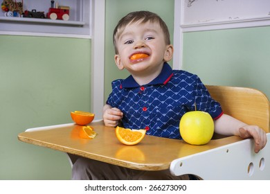 Toddler eating fruit and being naughty