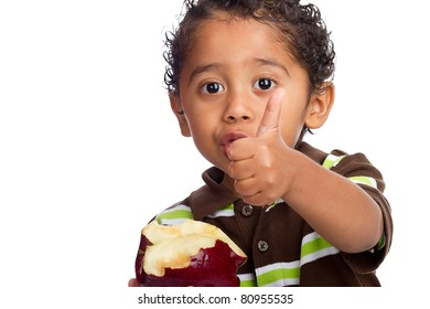 Toddler Eating Fruit and Giving Thumb Up