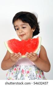 toddler eating watermelon