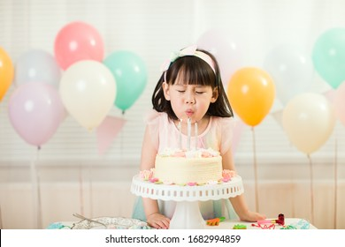 toddler girl celebrating her 4th birthday at home