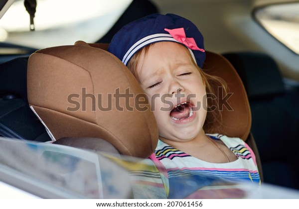 toddler girl crying in car