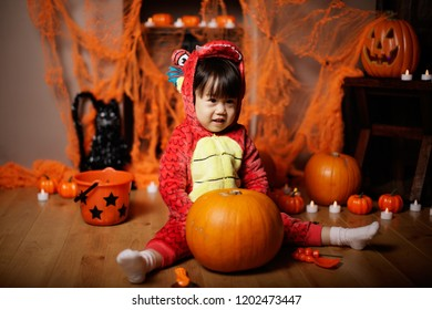 Toddler girl dressed up playing in Halloween party