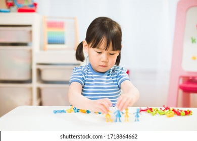 toddler girl learning counting and math for homeschooling