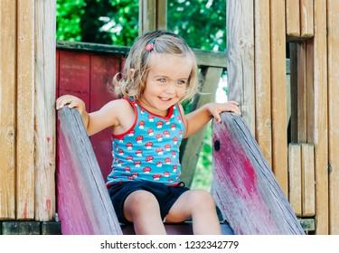 Toddler girl on playground slide – Kempen, Germany, Europe