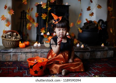 Toddler girl playing in Halloween party