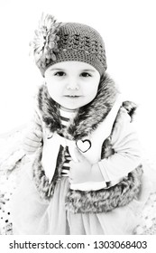 Toddler girl playing in the snow