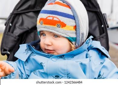 Toddler girl portrait in stroller – Hindeloopen, Friesland, Netherlands