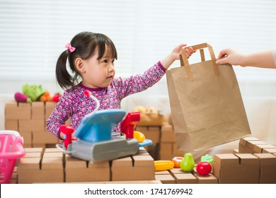 toddler girl pretend play sweet shop keeper at home