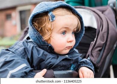 Toddler girl sitting in stroller – Kempen, Germany, Europe