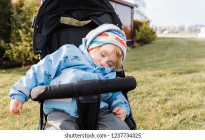 Toddler girl sleeping in stroller – Hindeloopen, Friesland, Netherlands