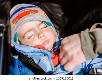 Toddler girl sleeping in stroller on a cold day with man's hand – Hindeloopen, Friesland, Netherlands