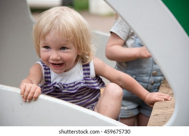 Toddler girl two years old play at playground.
