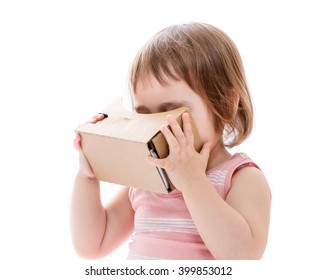Toddler girl using a new virtual reality headset isolated on white background