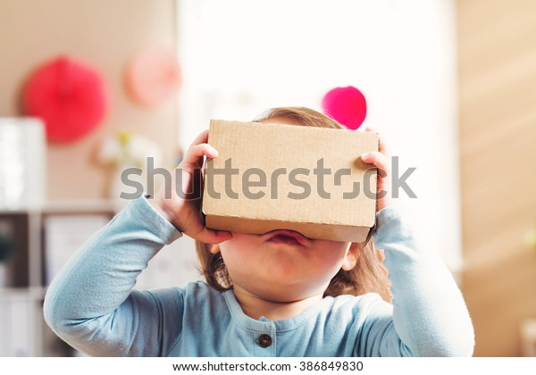 Toddler girl using a new virtual reality headset