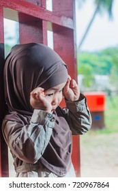 Toddler girl wearing hijab at the park