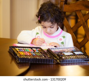 Toddler Girl Working on an Art Project