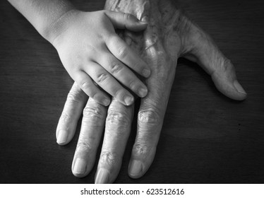 Toddler and grandfather hands