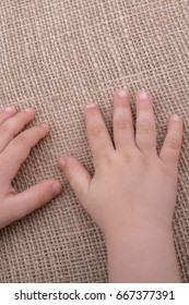 Toddler hand with canvas linen background
