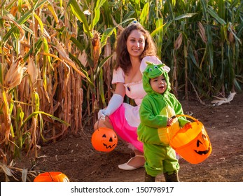 Toddler and his mother dressed up in cute costumes at the corn maze.