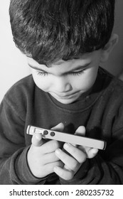 Toddler holds cellular phone in his hands