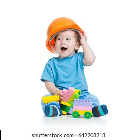 Toddler kid in hardhat plays with toy blocks isolated over white background