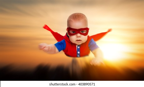 toddler little baby superhero with a red cape flying through the sky