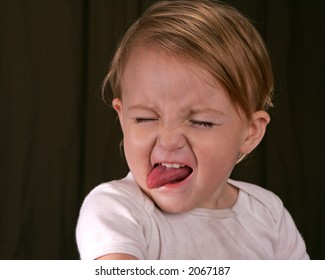 A toddler making a face