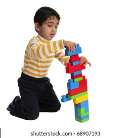 Toddler Making a tall Building with Blocks