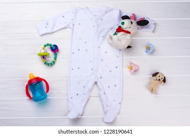 Toddler pajama clothes and toys. Plush dogs, pacifiers, rattle and bottle.