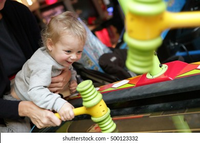 Toddler playing in attraction at amusement park
