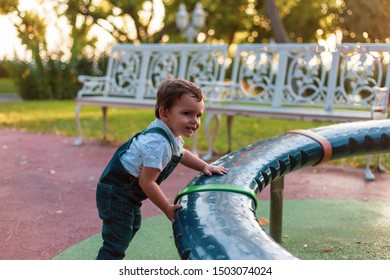 Toddler playing in playpen during sunset with warm colors