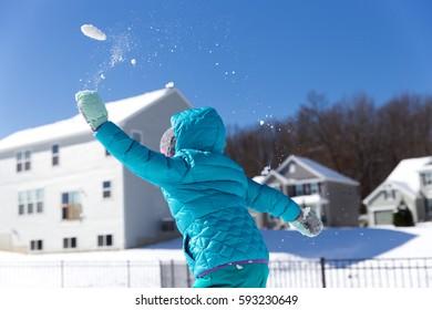 Toddler Playing in Snow