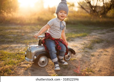Toddler posing with toy race car