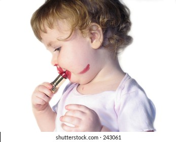 toddler putting on red lipstick on white background